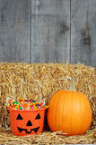 Halloween candy and pumpin in barn Stock Image