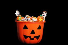 Halloween candy in pumpkin Stock Images