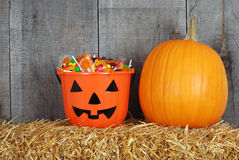 Halloween candy in pumpkin bucket Royalty Free Stock Image