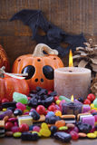 Halloween Candy with pumpkins on dark wood background. Royalty Free Stock Photo