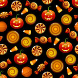Halloween candy seamless pattern with pumpkins. Seamless texture with Halloween sweets, candy corn and pumpkins on black background. Vector illustration Royalty Free Stock Image