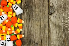 Free Halloween Candy Side Border Against Rustic Wood Royalty Free Stock Image - 59099876