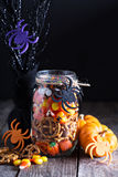 Halloween candy and snacks in a jar. On dark background Stock Image