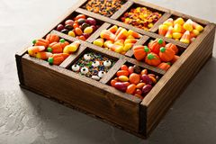 Halloween candy in a wooden box Stock Images