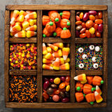 Halloween candy and sprinkles in wooden box Royalty Free Stock Image