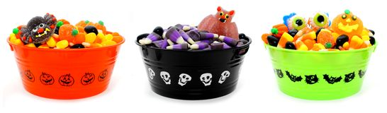 Halloween candy. Three unique Halloween bowls filled with assorted candy royalty free stock photography