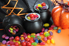 Halloween candy in trick or treat carry cauldrons closeup. Stock Photo