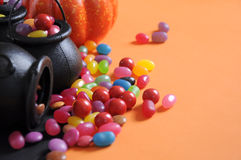 Halloween candy in trick or treat carry cauldrons with witches hat - closeup with copy space. Royalty Free Stock Photos