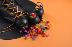 Halloween candy in trick or treat carry cauldrons with witches hat Royalty Free Stock Images