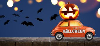 Halloween pumpkin on car stock photo