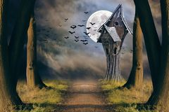 Halloween card with full moon and creepy house Stock Photos