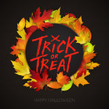 Halloween card, trick or treat handwritten text on black banner with autumn leaves Stock Photography