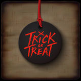 Halloween card, trick or treat handwritten text on black banner Stock Photography