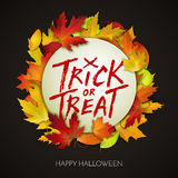 Halloween card, trick or treat handwritten text on white banner with autumn leaves Royalty Free Stock Images