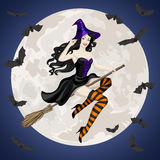 Halloween card with witch flying on broom Stock Photo