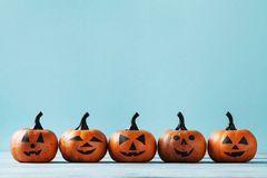 Halloween Card With Funny Pumpkin Heads On Turquoise Background. Stock Photography