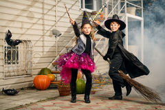 Halloween carnival. Happy children in a costumes of witches and wizards celebrating halloween. Trick or treat. Halloween party Royalty Free Stock Photo