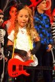 Halloween carnival pretty little guitarist girl Stock Photography