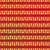 Halloween cartoon. Candy corn on brown with abstract stripes. Halloween vector seamless pattern. Hand drawn sketchy tileable background, design element for Stock Image
