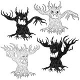 Four Halloween evil tree. Halloween cartoon set of two pairs of aggressive evil trees in stencil and outline vector designs Royalty Free Stock Photo