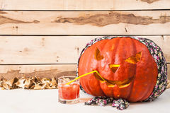 Halloween.  Carved pumpkin in bandana on a wooden background Royalty Free Stock Photos