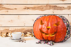 Halloween.  Carved pumpkin in bandana on a wooden background Stock Images