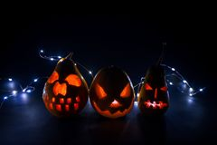 Halloween backgrounds wallpaper. Halloween carved pumpkin on dark background on holiday, three different pumpkin backgrounds wallpaper for design stock photos
