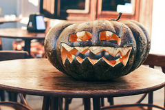 Halloween carved pumpkin on a street cafe table Royalty Free Stock Photos