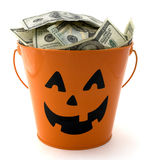 Halloween Cash. Halloween bucket filled with cash Stock Images