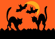 Halloween Cat Fight. Two cats on a fence square off by arching their backs, bats flying past a crescent moon,  in silhouette Royalty Free Stock Photos
