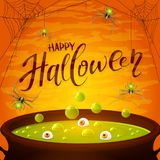 Halloween cauldron with green potion and spiders on orange backg Royalty Free Stock Images