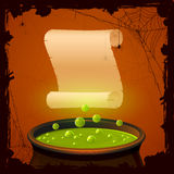 Halloween cauldron and paper Stock Photography