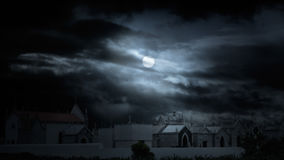 Halloween cemetery. Old european cemetery in a cloudy full moon night. Added some digital noise Stock Image