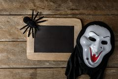 Halloween Chalk board and black toy spider, Witch mask Stock Photos