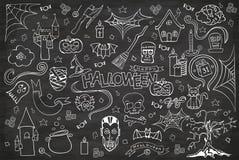 Halloween chalkboard hand drawn doodle cartoon set. Halloween chalkboard vector hand drawn doodle cartoon set of objects and symbols Royalty Free Stock Image