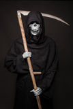 Halloween character: Death. Studio portrait on black background Royalty Free Stock Image