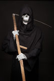 Halloween character: grim reaper. Studio portrait on black background Stock Photography