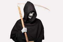 Halloween character: grim reaper. Studio portrait isolated on white background Royalty Free Stock Image