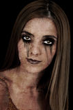 Halloween Character: Zombie Girl. Portrait of a young zombie woman over a black background Royalty Free Stock Photography