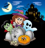 Halloween characters before mansion Stock Photography