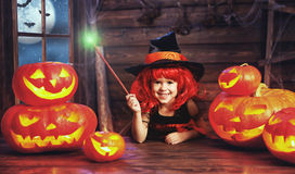 Halloween. child little witch with magic wand and pumpkin Jack Stock Photos