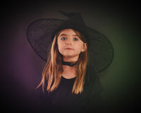 Halloween Child Witch on Black Background Stock Photography