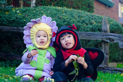 Halloween Children. Two sisters in their halloween costumes royalty free stock photo