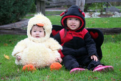 Halloween Children. Infant and Toddler in their Halloween Costumes royalty free stock photos