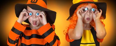 Children in costumes for Halloween scare friends. stock photo