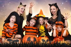 Children with moms celebrating Halloween. royalty free stock photography