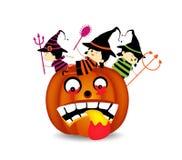 Halloween children wearing costume on pumpkin Stock Photography