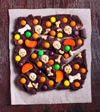 Halloween chocolate candy bark,. Over paper  top view Royalty Free Stock Photography