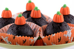 Halloween chocolate cupcakes. On pale green plate on white background in horizontal format Royalty Free Stock Photography