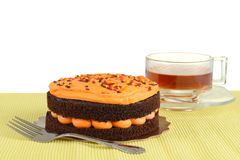 Halloween chocolate orange cake with tea Royalty Free Stock Photo
